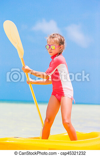 Little girl kayaking during summer vacation in Africa