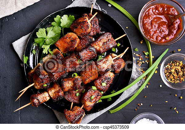 Bbq meat on wooden skewers - csp45373509
