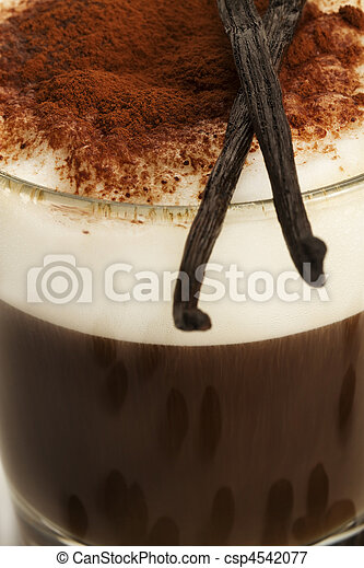 closeup on coffee with milk froth and chocolate powder with vanilla beans on top - csp4542077