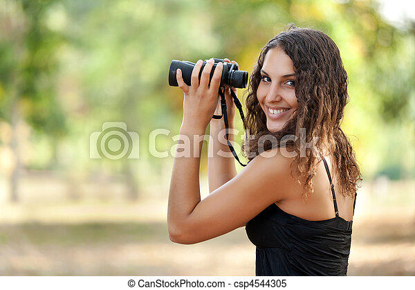 woman watching wildlife - csp4544305