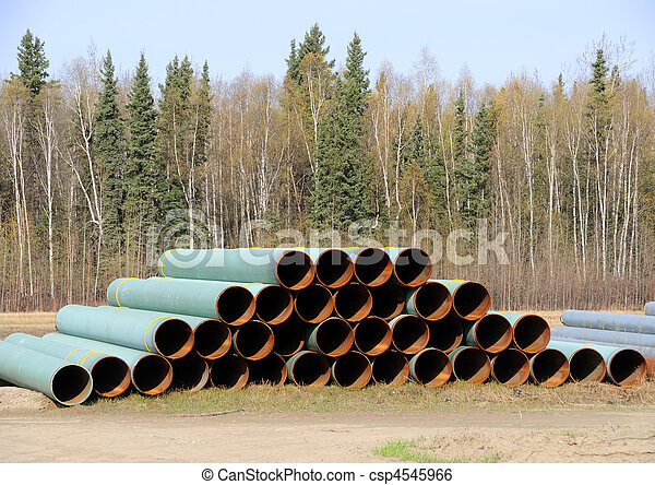 Stacked Pile of Pipe in an Industrial Yard - csp4545966