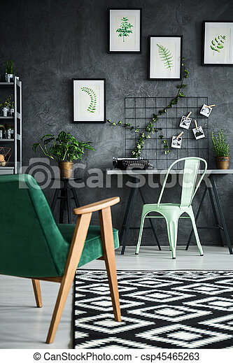Stylish studio flat with plants and comfortable armchair