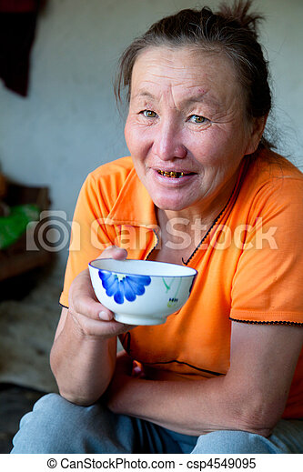 A woman of Asian appearance drinking tea - csp4549095