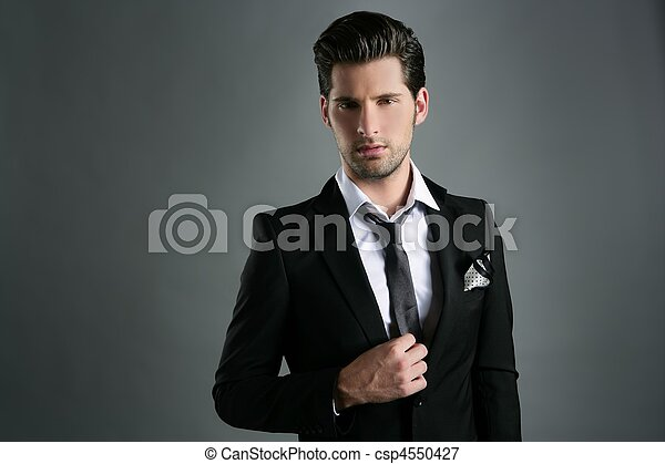 Fashion young businessman black suit casual tie - csp4550427