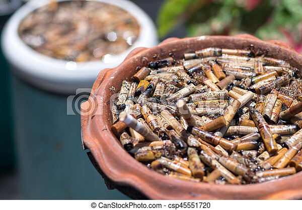 Big pile of put out cigarettes in an ashtray. Smoking, smoker, addiction, health hazard, lung cancer concept.