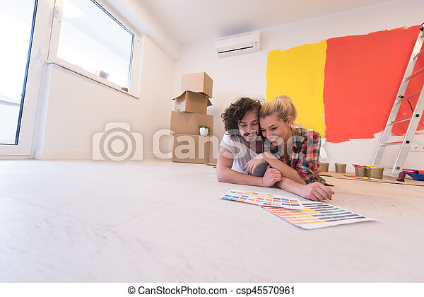 Happy young couple relaxing after painting - csp45570961