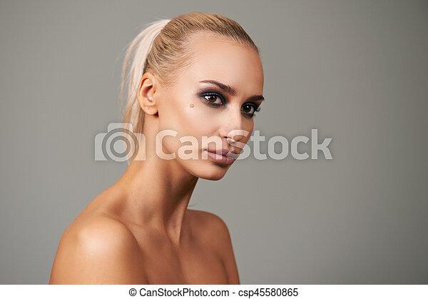 Beautiful young woman with bright make-up. Beauty fashion