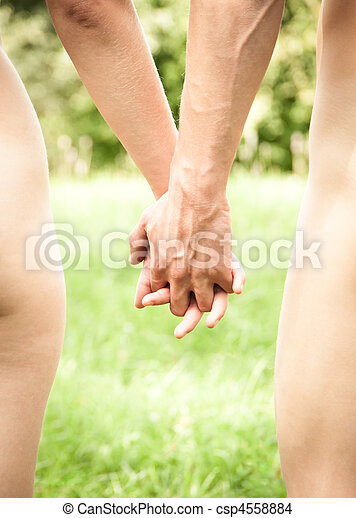 Young couple walking hand in hand  - csp4558884