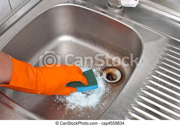Person cleaning the kitchen sink with a glove  - csp4559834