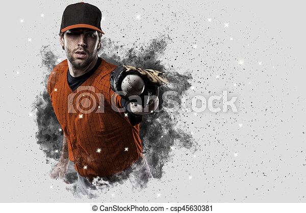 Baseball Player with a orange uniform coming out of a blast of smoke .