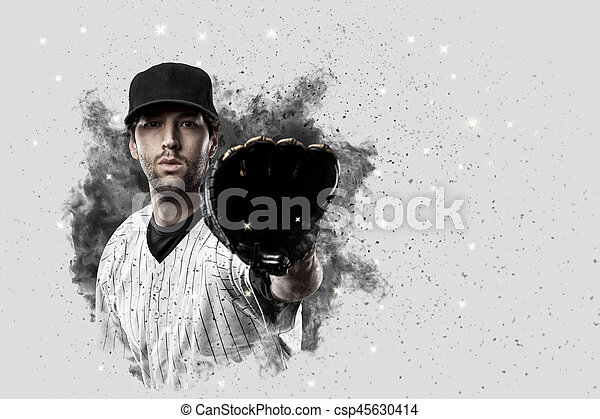 Baseball Player with a white uniform coming out of a blast of smoke .