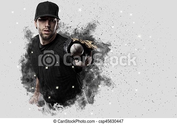 Baseball Player with a black uniform coming out of a blast of smoke .