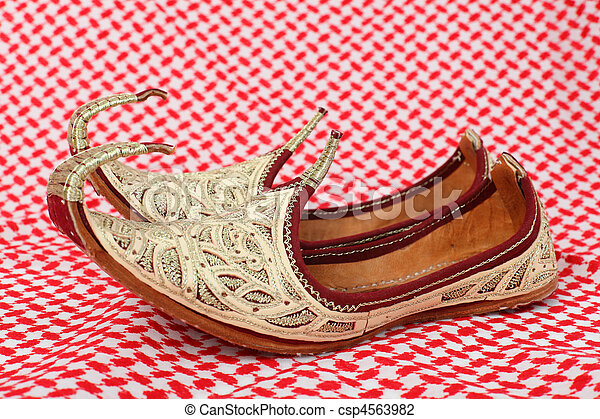 Traditional oriental shoes over arabic cloth - csp4563982