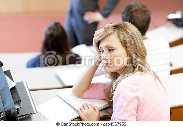 Portrait of a bored female student during a university lesson - csp4567953