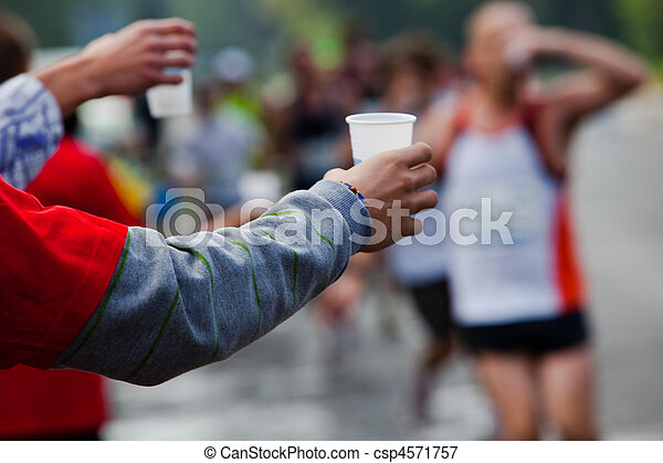 Runner take a water in a marathon race - csp4571757