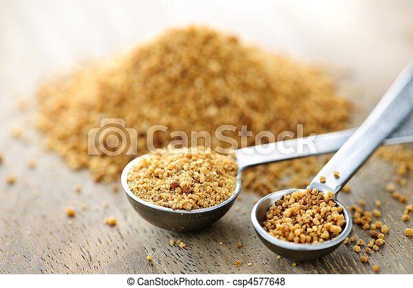 Coconut palm sugar in measuring spoons - csp4577648
