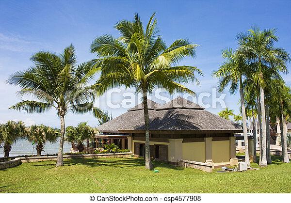 Image of a tropical beach resort building at Jerudong Beach, Brunei.