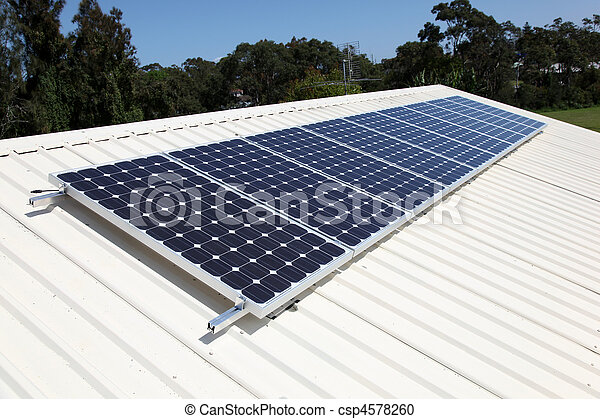 Residential roof top solar panel cells. Solar energy is becoming an important part of the energy mix. - csp4578260