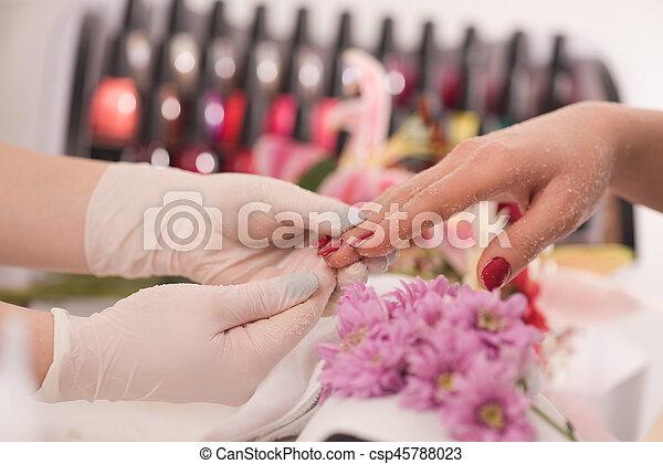 Woman hands receiving a manicure - csp45788023