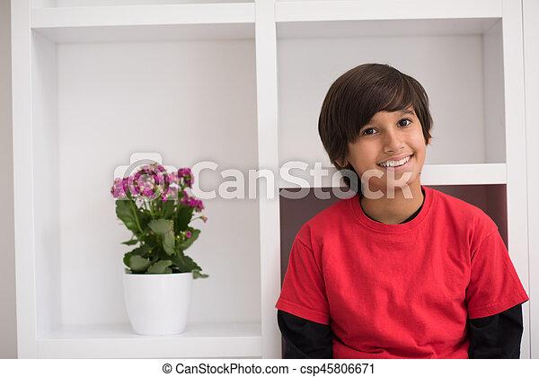young boy posing on a shelf - csp45806671