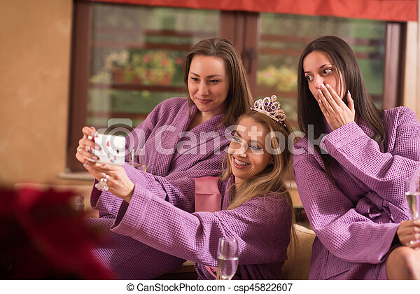 girls doing Selfy on  bachelorette party - csp45822607