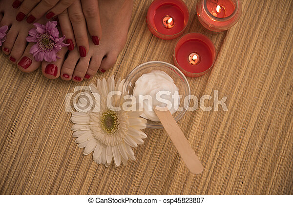 female feet and hands at spa salon - csp45823807