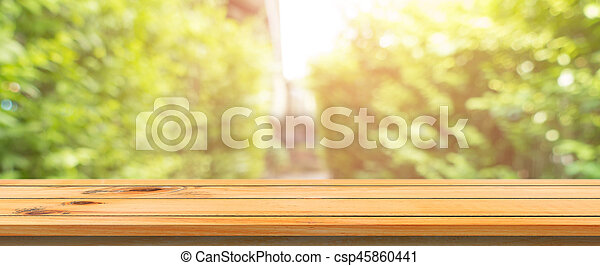 Wooden board empty table blurred background. Perspective brown wood table over blur trees forest background - can be used mock up for display or montage your products. spring season. panoramic banner.