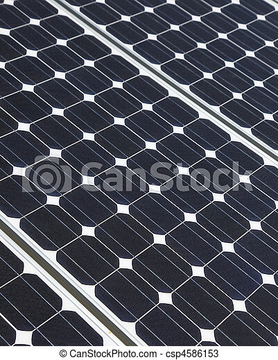 Closeup of solar panel cells mounted on roof top. Solar energy is becoming an important part of the energy mix. - csp4586153
