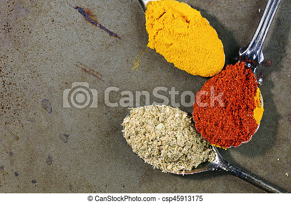 Spices and spoons background - csp45913175