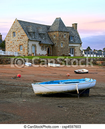 Ancient house and boats on a mooring - beautiful scenery at sunset - csp4597603