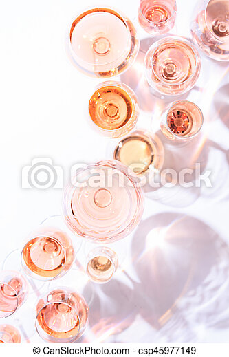 Many glasses of rose wine at wine tasting. Concept of rose wine and variety - csp45977149