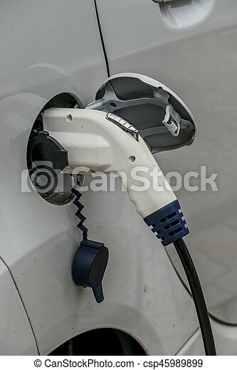 electric car at charging station. symbol of ecology, environmental protection, innovation