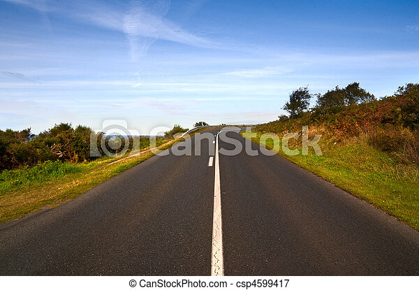road in evening lights on the cliff - right turning - csp4599417