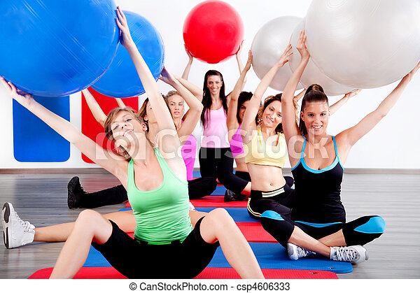 people doing stretching exercise with fitness balls - csp4606333