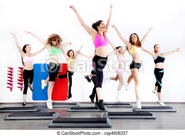 group of women doing aerobics on stepper - csp4606337