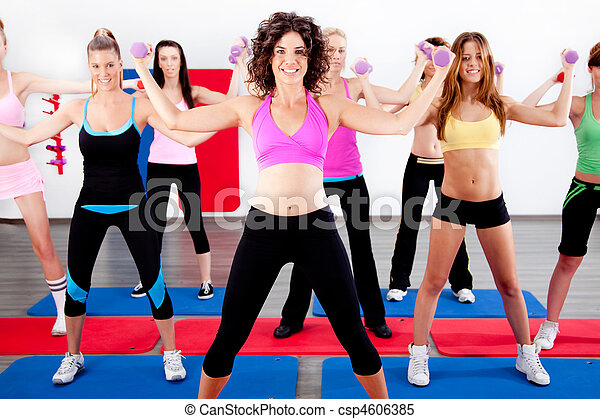women doing aerobics with dumbbell - csp4606385