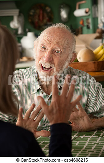 Senior couple at home focusing on angry man - csp4608215