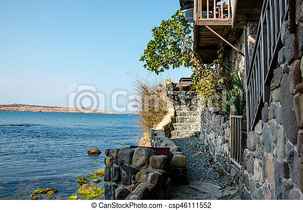 sea view with stone wall and stairway - csp46111552