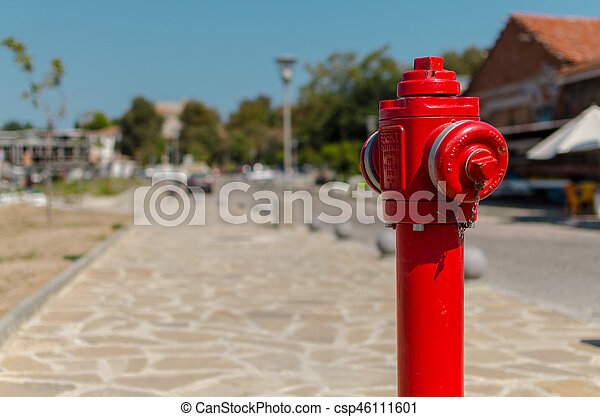 red fire hydrant on blurred background - csp46111601