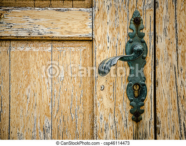 old wooden door with door knob - csp46114473