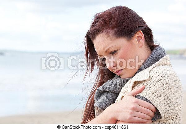 Pensive woman wondering alone  - csp4611861