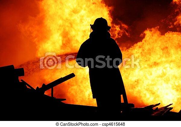 Fireman fighting a fire - csp4615648