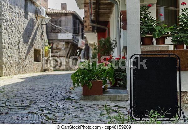 view of quiet street in old village - csp46159209