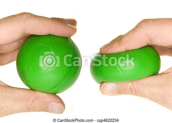 A stock photograph of a man's hand squeezing a green stress ball. - csp4622234