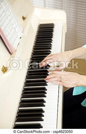 Pianist Plays Church Hymns - csp4623050