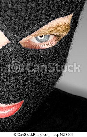 A stock photograph of an attractive woman wearing a balaclava. - csp4623906