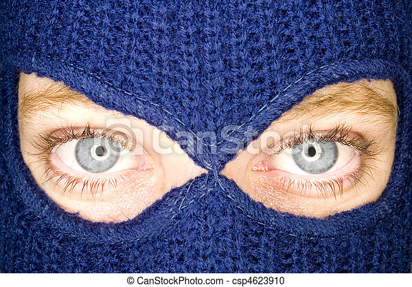 A stock photograph of an attractive woman wearing a balaclava. - csp4623910