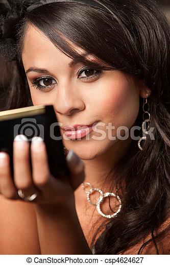 Beautiful Latina Woman with Compact - csp4624627