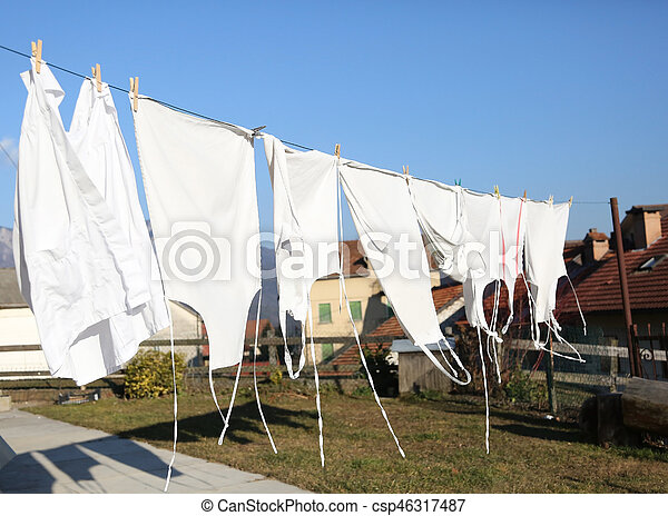 freshly washed white aprons they dry in the hot sun in a village in the mountains