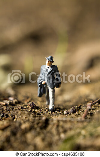figurines in the dirt - csp4635108